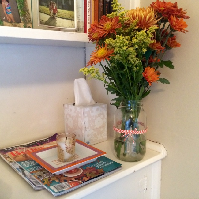Guest Room bedside - NEST Birchwood Pine Candle + Southern Living Magazine + Fall flowers in a mason jar.